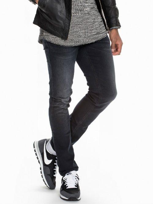 svarta nudie jeans